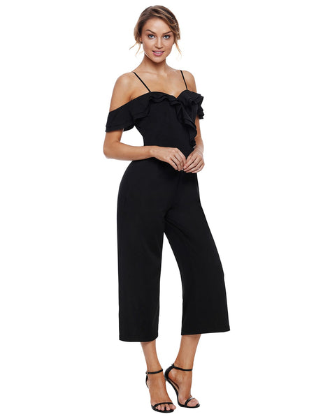 Front view of gorgeous model wearing black sweetheart neckline cold-shoulder jumpsuit