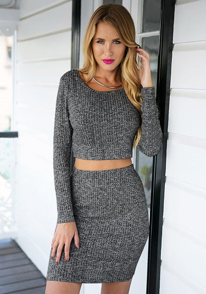 Front view of gril in grey knitted skirt co-ord set