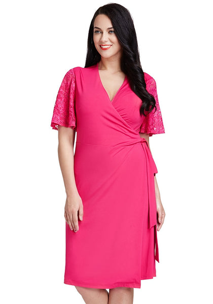 Front view of lady in hot pink plunge wrap-style dress