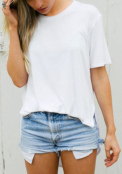 Front view of lady in white curved hem classic tee matched with denim shorts