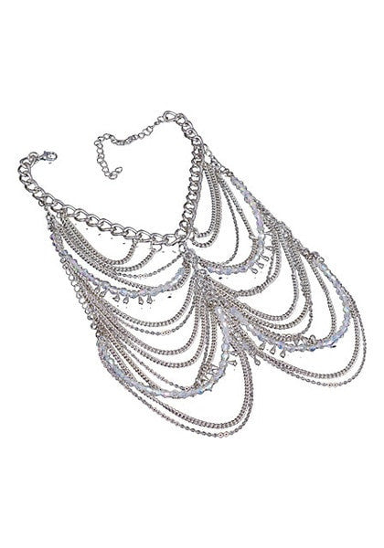 Front view of layered silver chain anklets