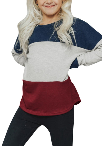 Front view of little girl wearing navy blue crewneck colorblock pullover girl sweater