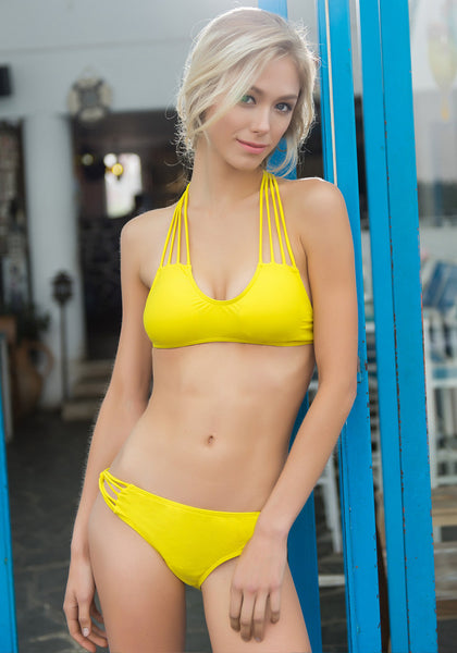 Front view of model in Caged Yellow Bikini Set
