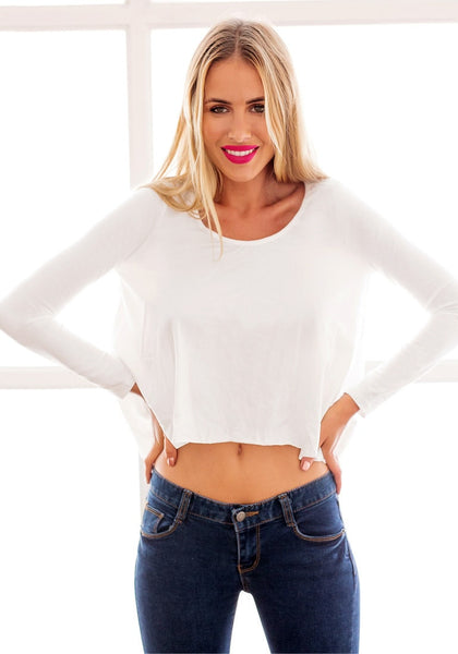 Front view of model in a white loose high-low tee