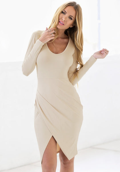 Front view of model in apricot draped wrap dress