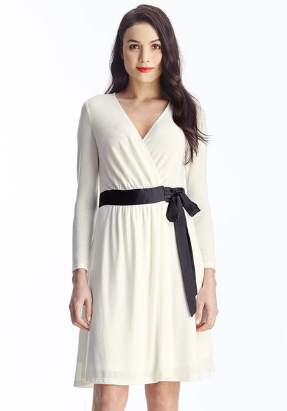Front view of model in apricot plunge wrap-style belted dress