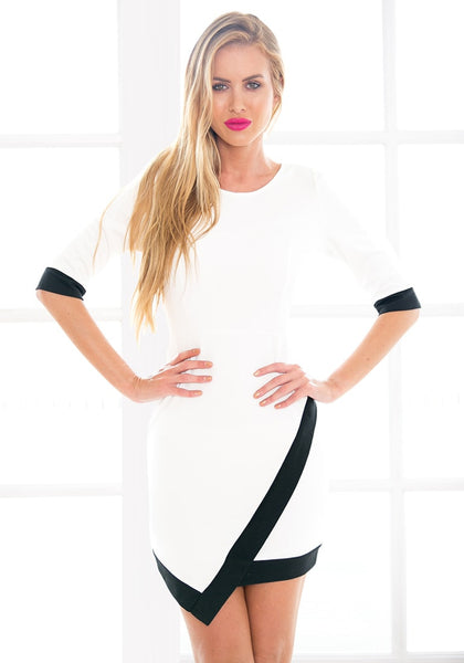Front view of model in asymmetrical wrap style dress