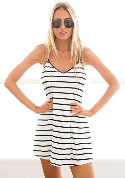 Front view of model in black and white stripe dress