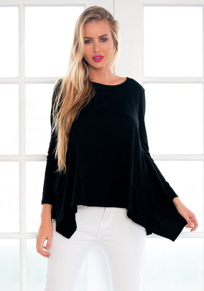 Front view of model in black asymmetrical blouse