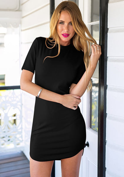 Front view of model in black curved-hem bodycon dress