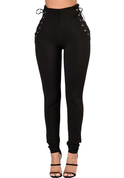 Front view of model in black lace-up sides grommet leggings