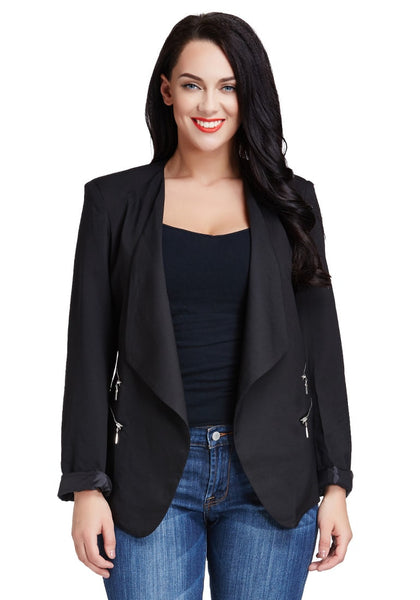 Front view of model in black padded-shoulder draped blazer
