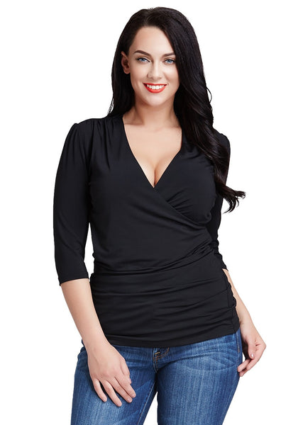 Front view of model in black ruched surplice top