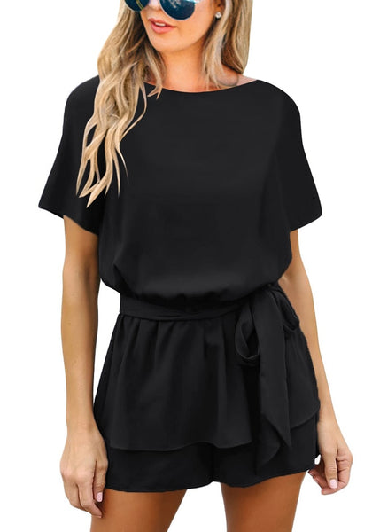 Front view of model in black short sleeves keyhole-back belted romper