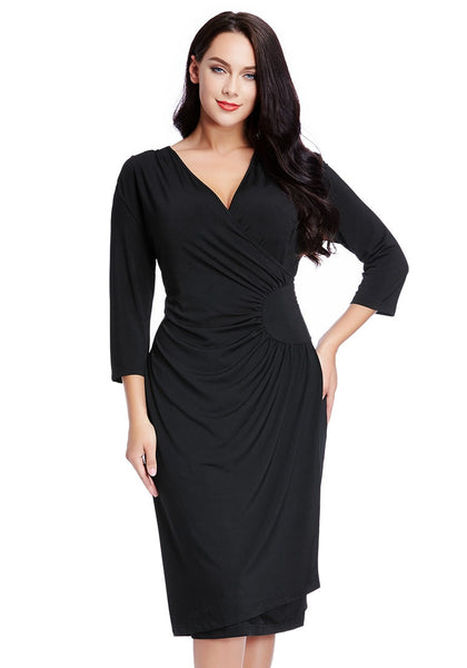 Front view of model in black side-patch wrap midi dress
