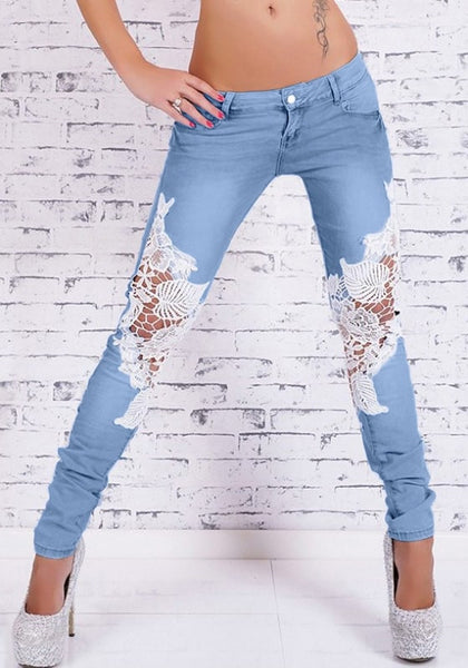 Front view of model in blue lace-paneled skinny jeans