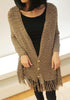 Front view of model in brown tassel knit shawl