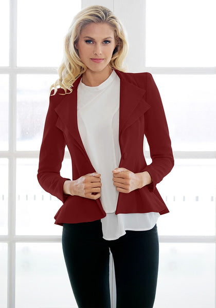 Front view of model in burgundy double lapel fit-and-flare blazer