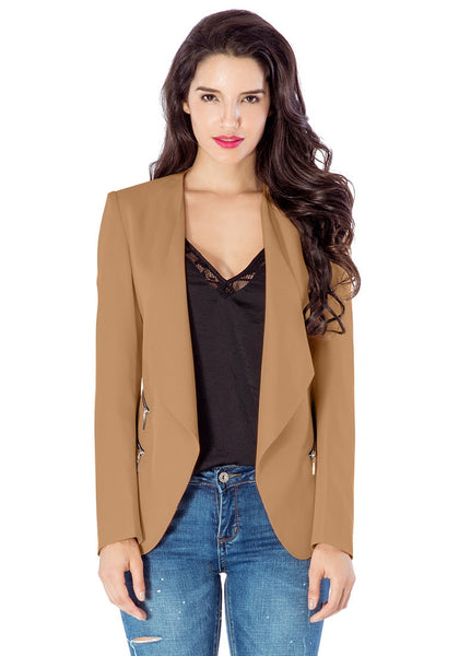 Front view of model in champagne draped blazer