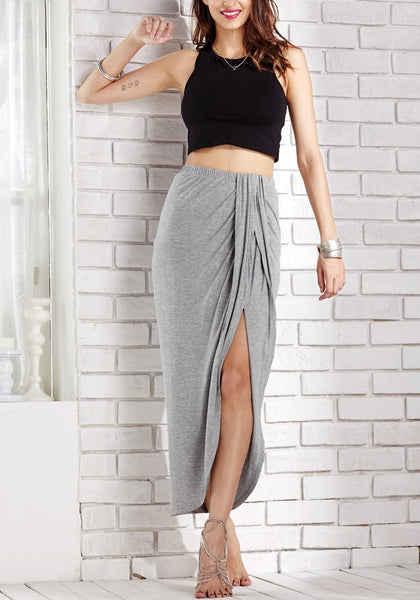 Front view of model in dark grey wrap maxi skirt