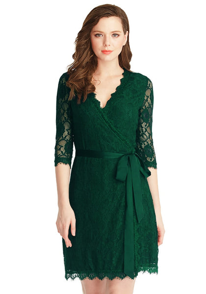 Front view of model in green lace overlay plunge wrap-style dress