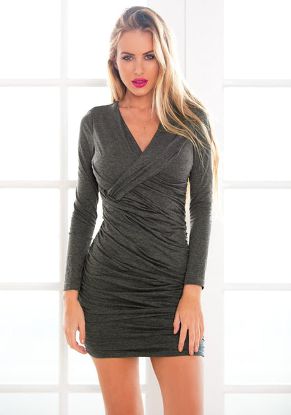 Front view of  model in grey surplice ruched bodycon dress