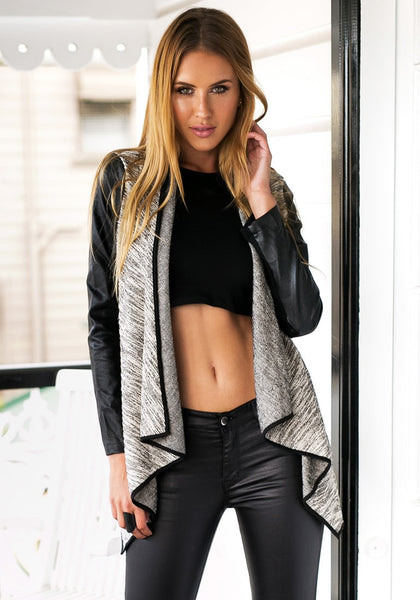 Front view of model in light grey draped cardigan and crop top