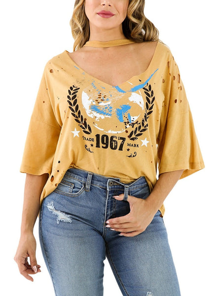Front view of model in mustard graphic-print distressed loose topFront view of model in mustard graphic-print distressed loose top