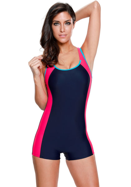 Front view of model in navy and hot pink racerback keyhole maillot swimsuit