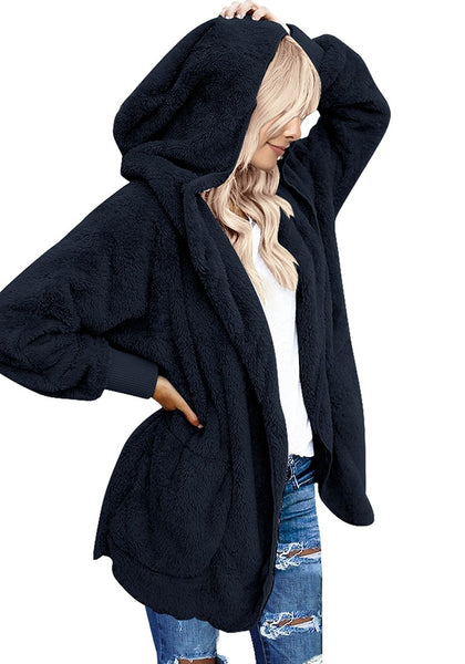 Front view of model in navy snuggle fleece oversized hooded cardigan