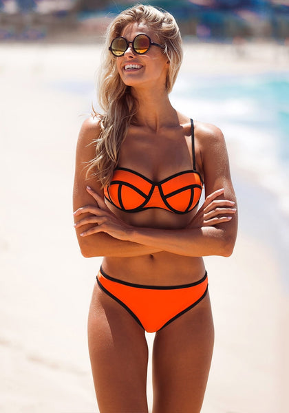Front view of model in neon orange bikini set