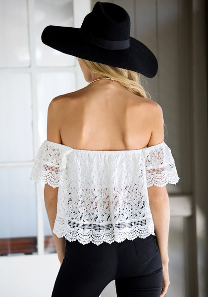 Front view of model in off shoulder top