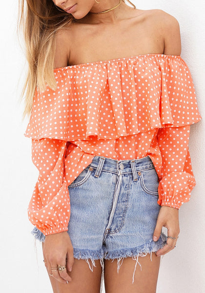 Front view of model in orange polka dots off-shoulder top