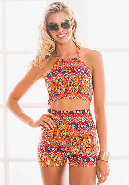 Front view of model in paisley print halter romper