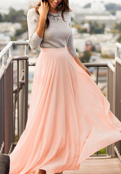 Front view of model in pink chiffon maxi skirt