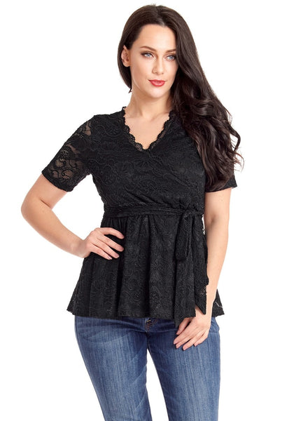 Front view of model in plus size black scallop-neck lace blouse