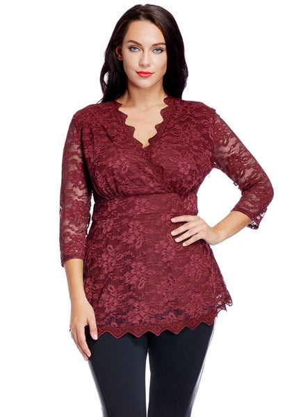 Front view of model in plus size burgundy lace scallop blouse