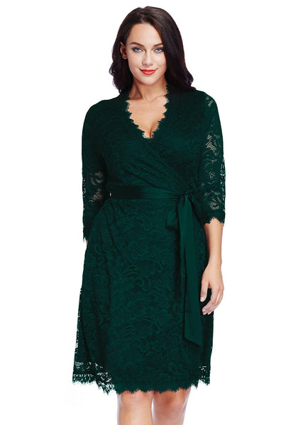 Front view of model in plus size deep green lace crop sleeves wrap dress