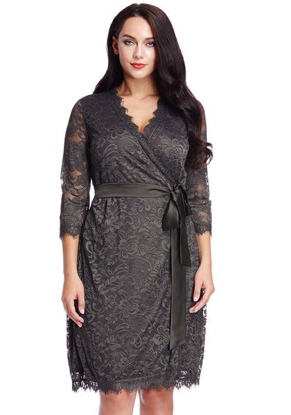 Front view of model in plus size grey lace crop sleeves wrap dress