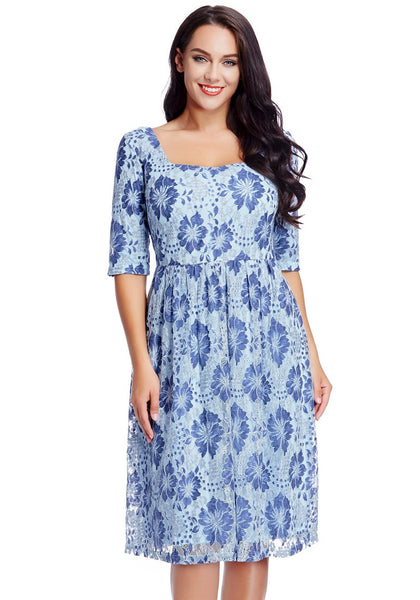 Front view of model in plus size light blue floral-print lace dress