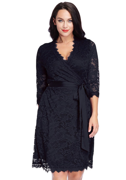 Front view of model in plus size navy lace crop sleeves wrap dress