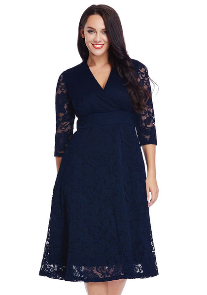 Front view of model in plus size navy lace surplice midi dress