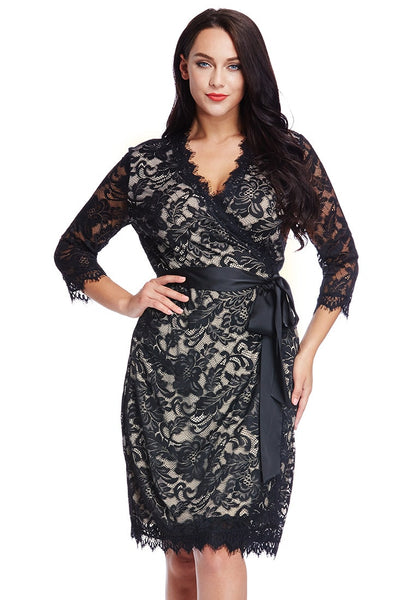 Front view of model in plus size neutral lace crop sleeves wrap dress