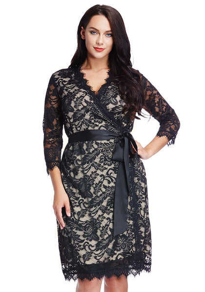 Front view of model in plus size neutral lace crop sleeves wrap dress with one hand at waist