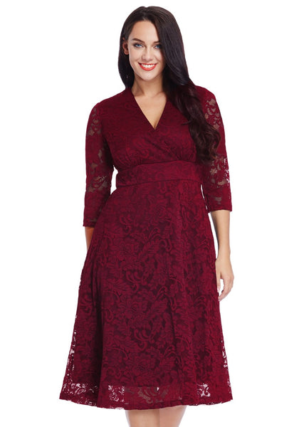 Front view of model in plus size red lace surplice midi dress
