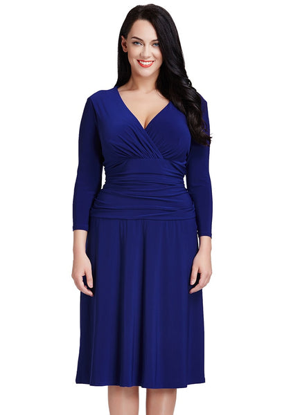 Front view of model in plus size royal blue ruched waist dress