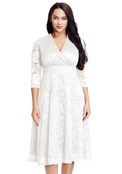 Front view of model in plus size white lace surplice midi dress