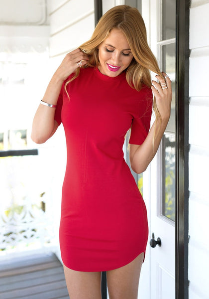Front view of model in red curved-hem bodycon dress
