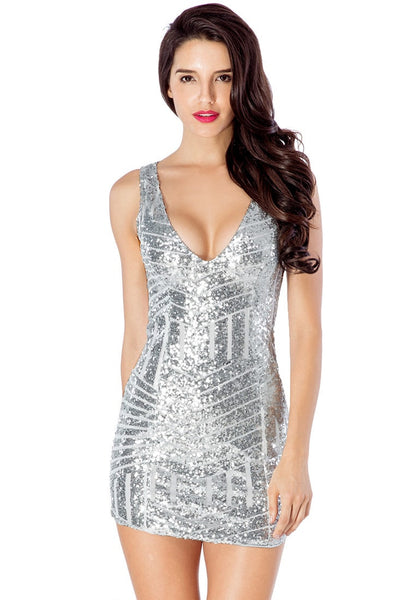 Front view of model in silver sequin party dress