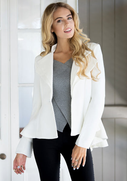 Front view of model in white double lapel fit-and-flare blazer